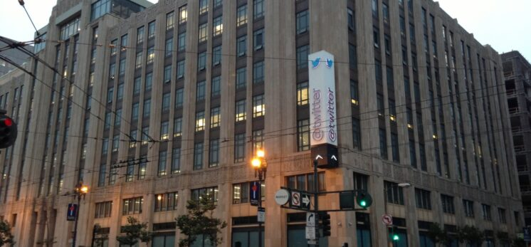 Picture of Twitter headquarters, a large, tall building, in San Francisco
