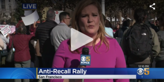 "Screenshot of newscaster with blonde hair and a microphone; text on-screen has CBS logo, ""Anti-Recall Rally,"" and ""San Francisco"" at the bottom"